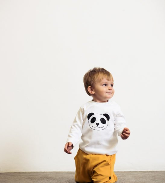 Model wearing Panda organic cotton long sleeved t-shirt by Tommy & Lottie ay Nurture Collective Ethical Baby Clothing