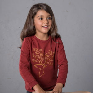 Girl wearing Robin Reindeer unisex organic sweatshirt with yellow embroidery by Cooee