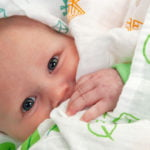 baby wrapped in Little Leaf Organics Muslin at Nurture Collective
