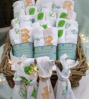 A basket of Little Leaf Muslins at Nurture Collective