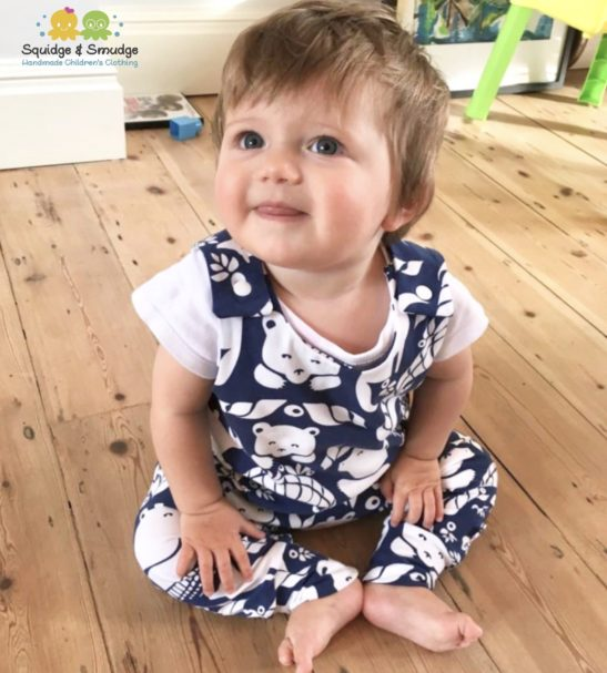 Baby wearing Organic Harem Romper by Squidge & Smudge
