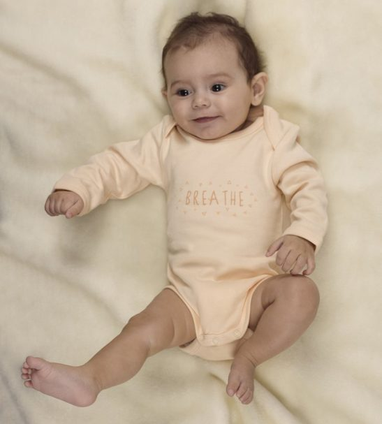 Baby wearing Breathe Organic Cotton Long Sleeved Baby Grow by Huggee Purewear at Nurture Collective Ethical Baby Clothing
