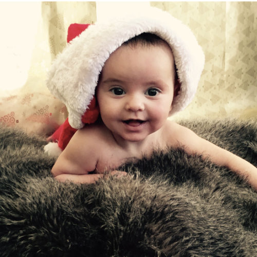Babys first Christmas photo taken by Mum- Nurture Collective Ethical Baby Clothing