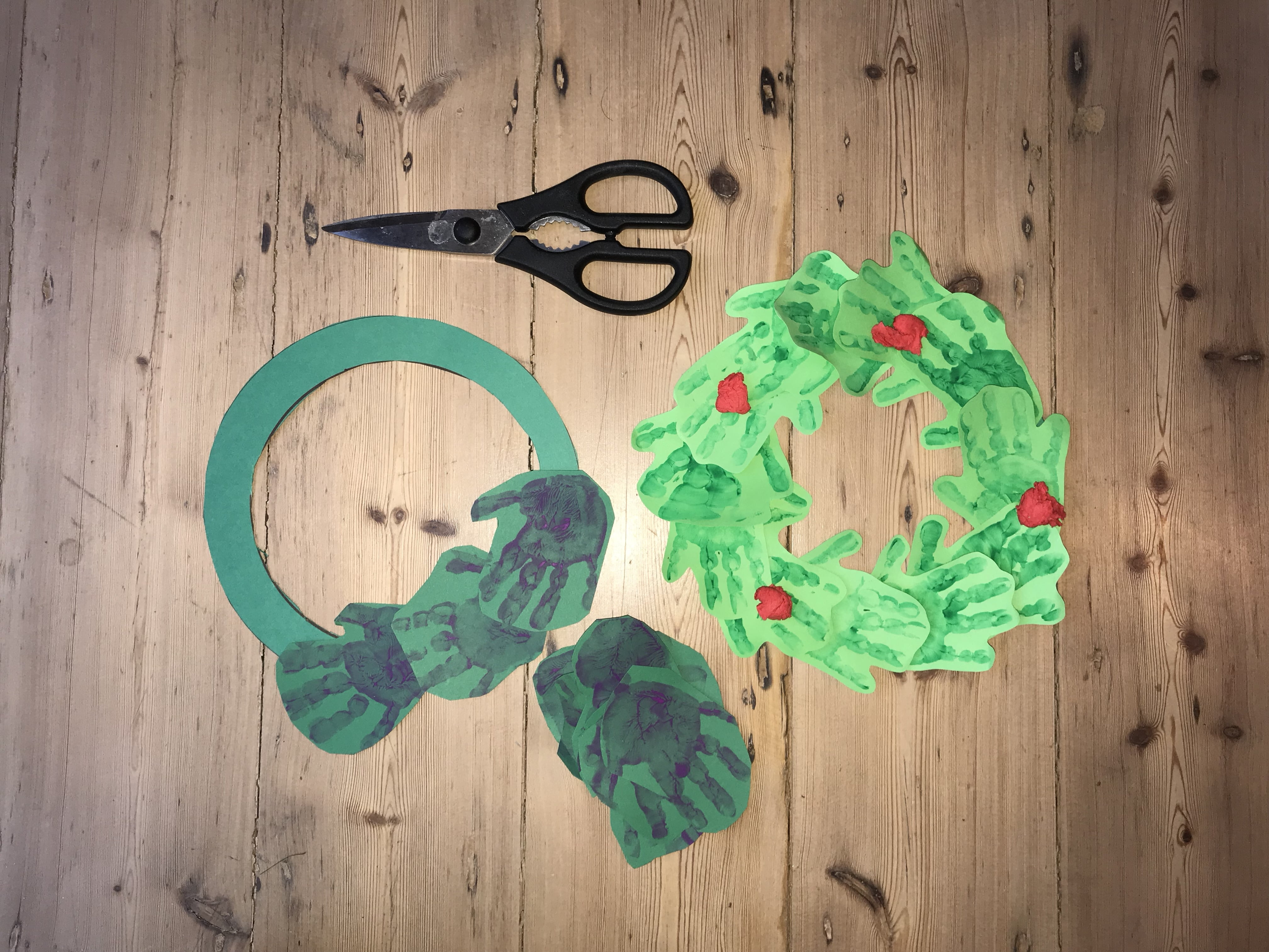 Hand print wreath making with Nurture Collective Ethical Baby Clothing