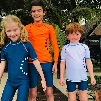 Kids wearing Blue Swim Shorts by Noma Swimwear at Nurture Collective Ethical Baby Clothing