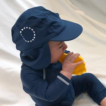 Baby wearing Blue & White Legionnaires Unisex Sun Hat by Noma Swimwear at Nurture Collective Ethical Baby Clothing