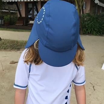 Girl wearing Blue & White Legionnaires Unisex Sun Hat by Noma Swimwear at Nurture Collective Ethical Baby Clothing