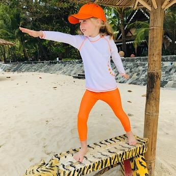 A Girl wearing White & Orange Swimwear Top by Noma Swimwear at Nurture Collective Ethical Baby Clothing