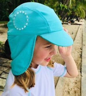 A Girl wearing a Unisex Turquoise Sun Hat by Noma Swimwear at Nurture Collective Ethical Baby Clothing