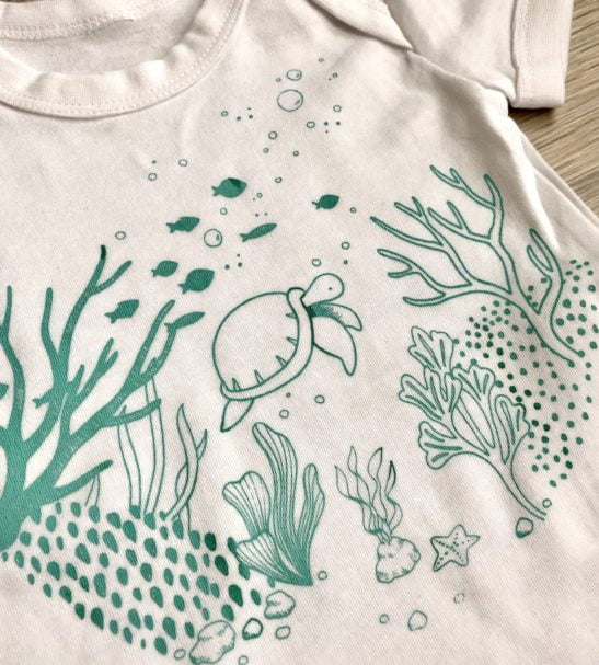 Flynn Reef Body Close Up by Little Drop in the Ocean at Nurture Collective Ethical Baby Clothing