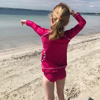 Magenta Bikini Bottoms and Long Sleeved Rash Top by Noma Swimwear at Nurture Collective Ethical Baby Clothing