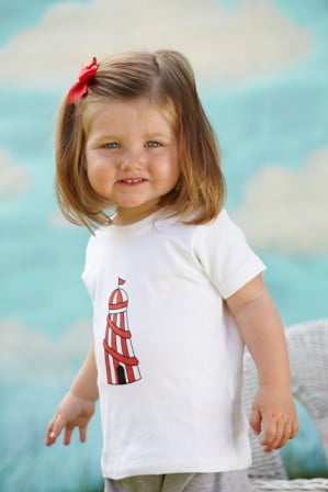 Little Girl wearing the Helter Skelter Short Sleeved T-Shirt by Tommy & Lottie at Nurture Collective