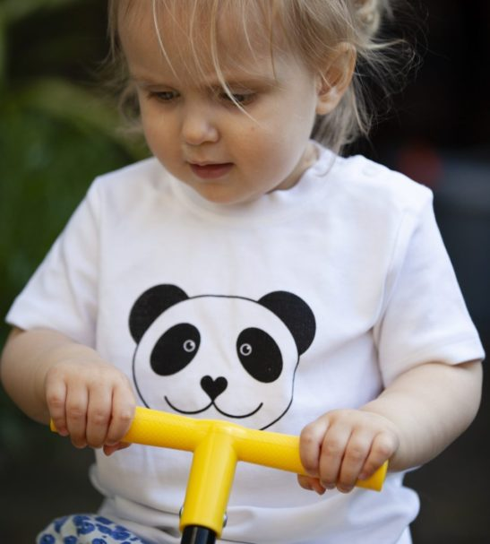 Little Girl wearing the Panda Short Sleeved T-Shirt by Tommy & Lottie at Nurture Collective