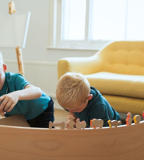 Children Playing with a Wooden Balance Board by Young & Learning at Nurture Collective