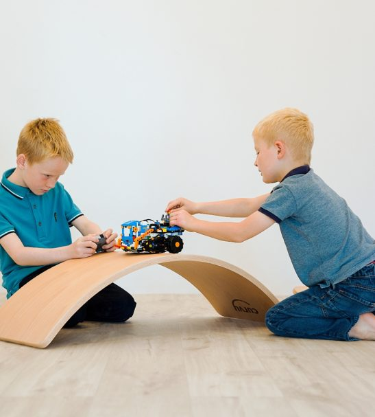 Two Child Playing with the Wooden Balance Boards by Young & Learning at Nurture Collective
