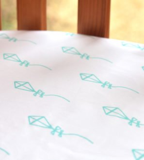 Fitted Baby Cot Bed Sheet in Blue Kite Print by Little Leaf Organic at Nurture Collective