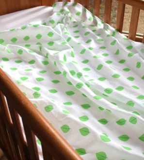 Leaf Print Baby Swaddle by Little Leaf Organic at Nurture Collective