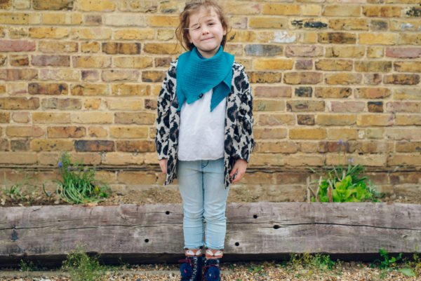 Girl wearing Ponchlin Sea Bandana scarf available at Nurture Collective