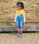 Girl wearing Ponchlin sunshine yellow scarf available at Nurture Collective