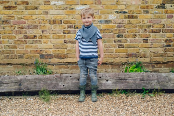 Boy wearing Ponchlin Gray scarf available at Nurture Collective