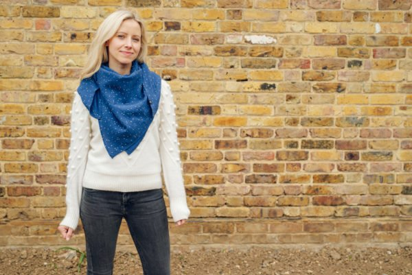 Mama's wearing Ponchlin Blue scarf available at Nurture Collective