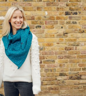 Mama wearing a Ponchlin Sea Green scarf available at Nurture Collective