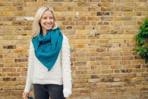 Mama wearing a Ponchlin TEAL scarf available at Nurture Collective