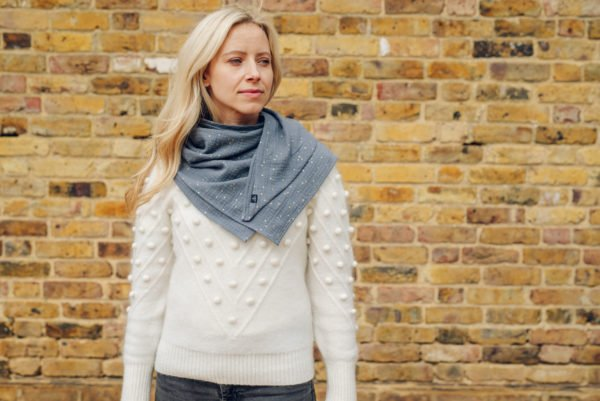 Mama wearing a Ponchlin Gray scarf available at Nurture Collective