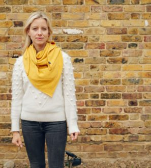 Mama wearing a Ponchlin Yellow scarf available at Nurture Collective
