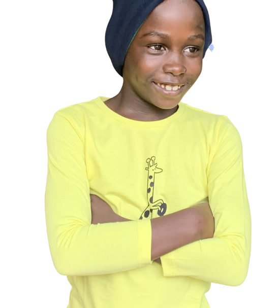 Girl Wearing Yellow Gerald the Giraffe T-Shirt by Cooee Kids at Nurture Collective Eco Friendly Kids Fashion