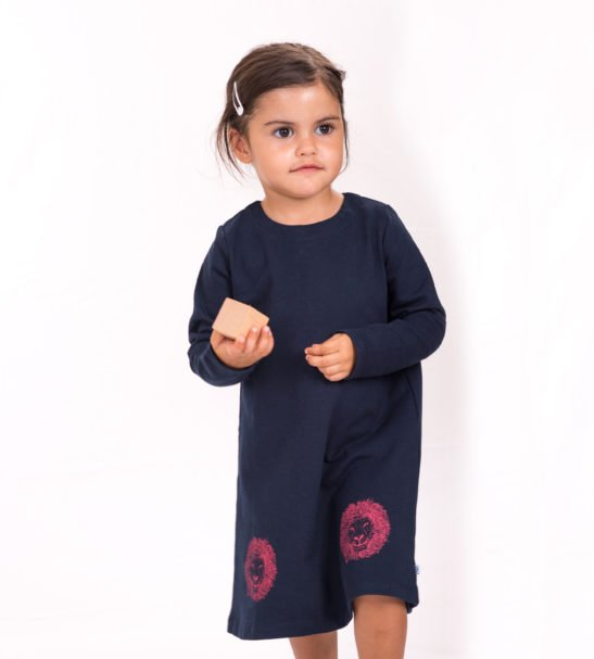 Girl wearing Leela Lion Dress By Cooee Kids at Nurture Collective
