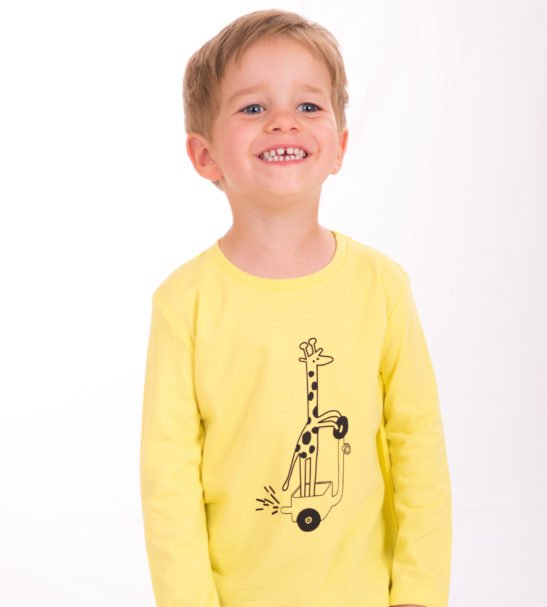 Boy Wearing Yellow Gerald the Giraffe T-Shirt by Cooee Kids at Nurture Collective Eco Friendly Kids Fashion