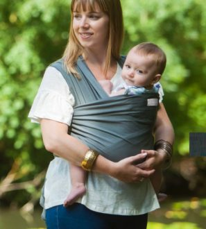 Mum carrying a baby in a Grey Baby Sling at Nurture Collective