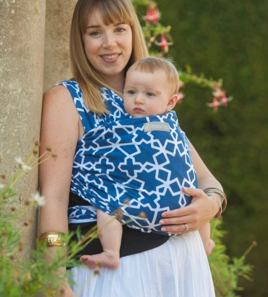 Mum carrying a baby in a Moroccan_Star Baby Sling at Nurture Collective