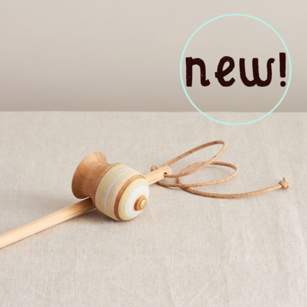 Spinning Top with String by Love Heartwood at Nurture Collective