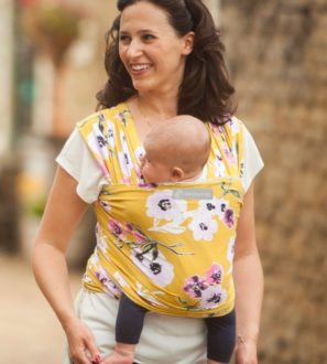 Mum carrying a baby in a Posy_Rosy Baby Sling at Nurture Collective