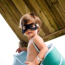 A toodler wearing a Kids Bandit mask ideal for halloween costumes at Nurture Collective.