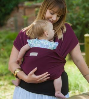 Mum carrying a baby in a Wine_Maroon Baby Sling at Nurture Collective