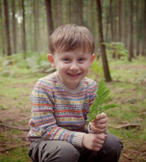 Little Boy Wearing Fairilse Jumper by Faraway Gang at Nurture Collective