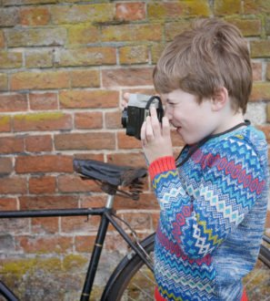 Little Boy Wearing Fairilse Jumper in Teal by Faraway Gang at Nurture Collective