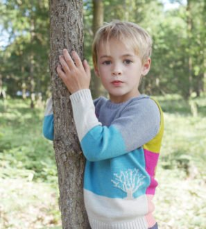 Little Boy Wearing Jacquard Motif Stripe & Colour Block Jumper by Faraway Gang at Nurture Collective