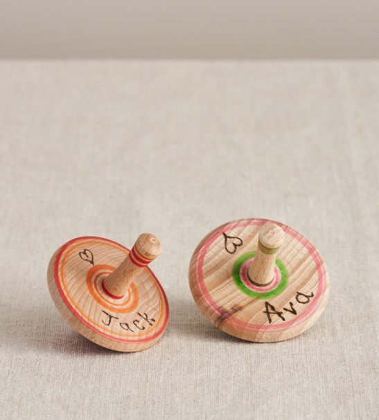 Custom Wooden Spinning Tops by Love Heartwood at Nurture Collective