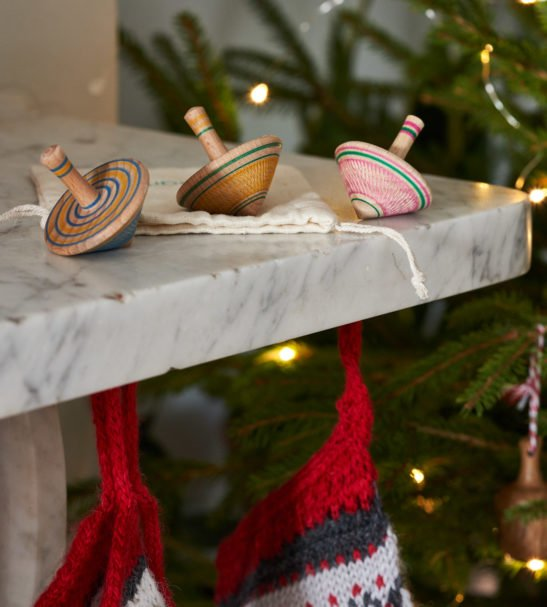 Set of Three Wooden Spinning Tops by Love Heartwood at Nurture Collective