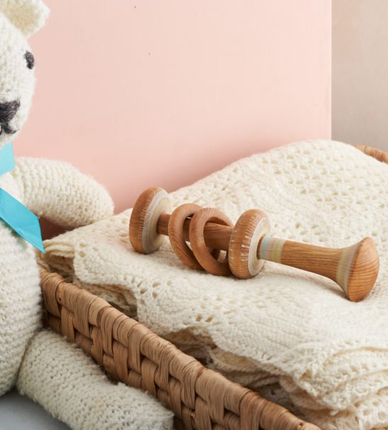 Close up of Wooden Baby Rattle by Love Heartwood at Nurture Collective
