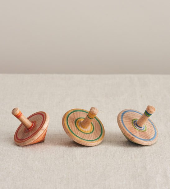 Set of 3 Wooden Spinning Tops by Love Heartwood at Nurture Collective