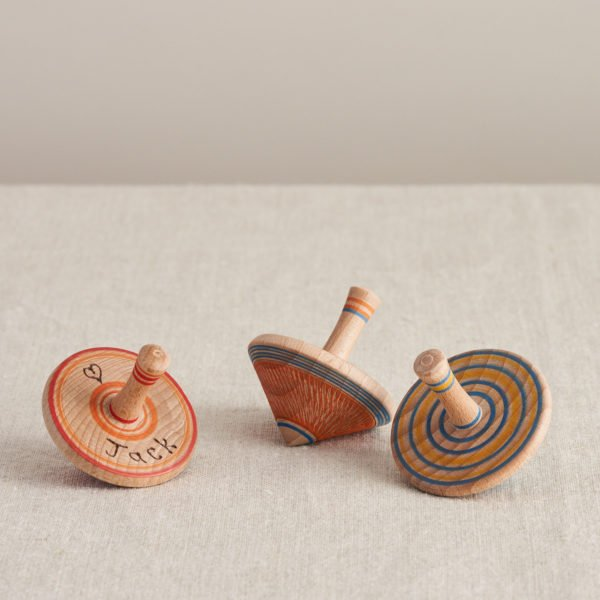 Wooden Spinning Tops by Love Heartwood at Nurture Collective