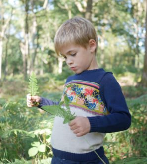 Little Boy Wearing Merino Forest Pattern Jumper by Faraway Gang at Nurture Collective