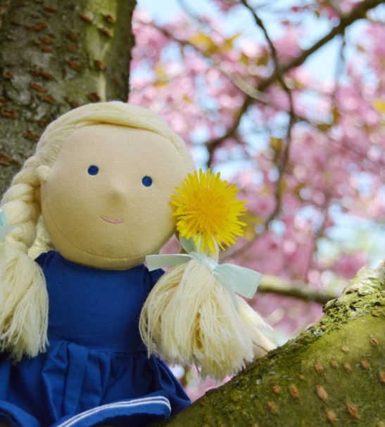 Lively Lea Soft Doll by Dear One World Sitting in a Tree at Nurture Collective