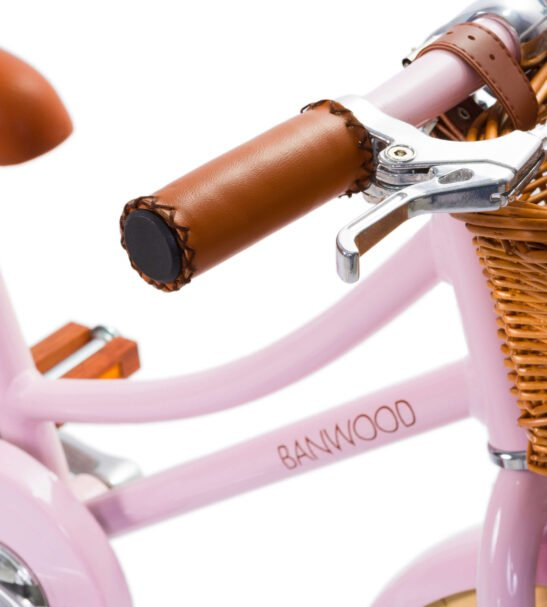 Close up of the Classic Pink Banwood Bike Handle bars and Basket now available at Nurture Collective