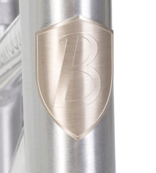A Close up of the Banwood Balance Bike Logo on the Chrome Bike now available at Nurture Collective